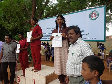RECEIVING AWARDS AT DISTRICT SPORTS DAY ABLED STUDENTS